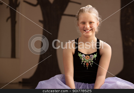 Pretty Ballet Student on Floor stock photo, Cute young ballet student sitting on the dance floor by Scott Griessel