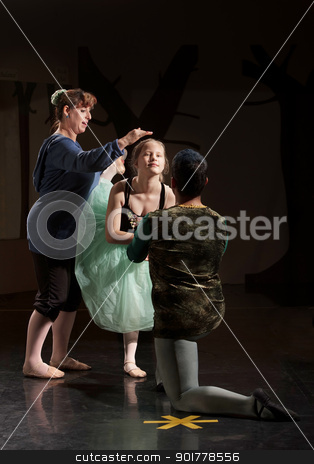 Ballet Dancer Helped by Teacher stock photo, Young ballet student is assisted by teacher during practice by Scott Griessel