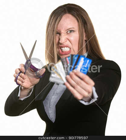 Woman With Credit Cards and Scissors stock photo, Angry woman with scissors and hand full of credit cards by Scott Griessel