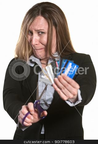 Nervous Woman Cuts Credit Cards stock photo, Nervous businesswoman with scissors and credit cards by Scott Griessel