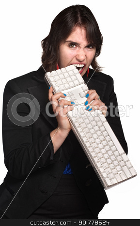 Angry Woman Bites Keyboard stock photo, Aggressive businesswoman chewing keyboard over white background by Scott Griessel