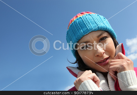 Woman outdoors with wool cap stock photo, Woman outdoors with wool cap by photography33