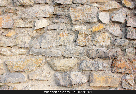 Wall of stones  stock photo, Wall of stones and cement in gray tones with an orange stone in a strong point. by Eduardo Rodriguez