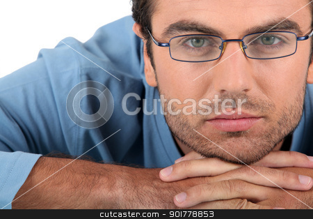Bored man wearing glasses stock photo, Bored man wearing glasses by photography33