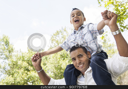 Hispanic Father and Son Having Fun in the Park stock photo, Hispanic Father and Son Having Fun Together Riding on Dad's Back in the Park. by Andy Dean