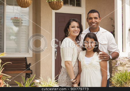 Small Hispanic Family in Front of Their Home stock photo, Hispanic Mother, Father and Daughter in Front of Their Home. by Andy Dean