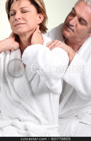 Husband giving wife neck massage stock photo, Husband giving wife neck massage by photography33