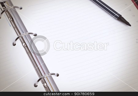 Blank Spiral Organizer Macro stock photo, Close-up image of blank spiral organizer with black marker pen by HypnoCreative