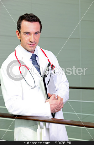 Doctor leaning against railing stock photo, Doctor leaning against railing by photography33