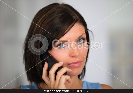 Brunette posing whilst on the telephone stock photo, Brunette posing whilst on the telephone by photography33