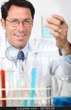 Scientist conducting an experiment stock photo, Scientist conducting an experiment by photography33