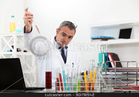 Man working in a laboratory stock photo, Man working in a laboratory by photography33