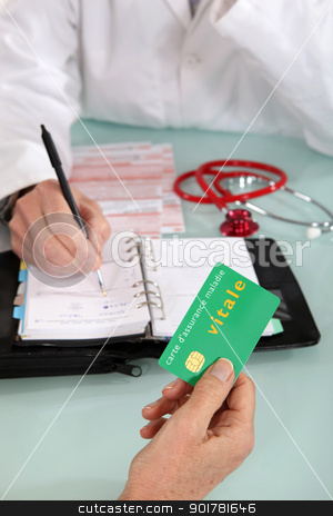 Patient handing social security card to doctor stock photo, Patient handing social security card to doctor by photography33