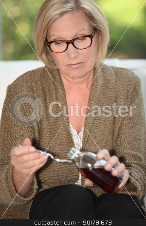 Woman taking syrup stock photo, Woman taking syrup by photography33