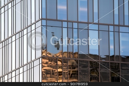 Office Building Window stock photo, Large wall of glass windows at a tall building. by Henrik Lehnerer