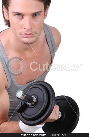 Young man lifting weights stock photo, Young man lifting weights by photography33