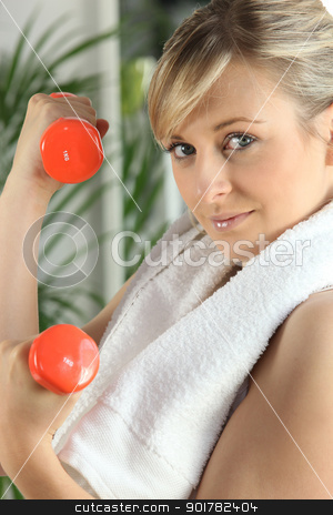 woman doing exercises with dumbbells stock photo, woman doing exercises with dumbbells by photography33
