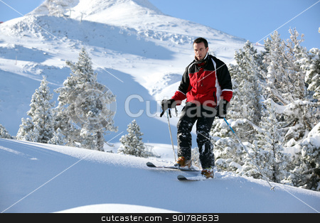 Male skier on a mountain stock photo, Male skier on a mountain by photography33