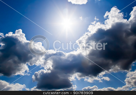 Blue sky stock photo, Bright sunrays in a blue cloudy sky by Alexey Popov