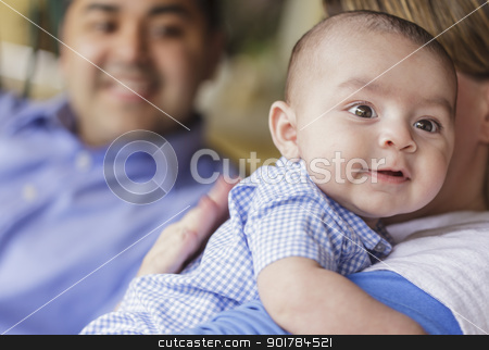Happy Attractive Mixed Race Couple Burping Their Son stock photo, Happy Attractive Mixed Race Couple Burping Their Smiling Son. by Andy Dean