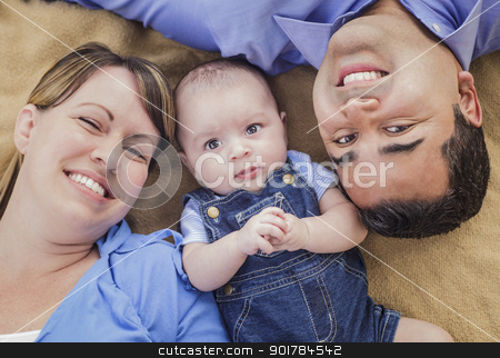 Mixed Race Family Playing on the Blanket stock photo, Mixed Race Family Playing Face Up on the Blanket. by Andy Dean