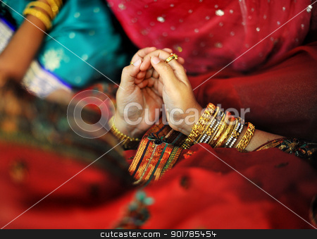 Indian Muslim prayer stock photo, Indian Muslim prayer in red sari by szefei