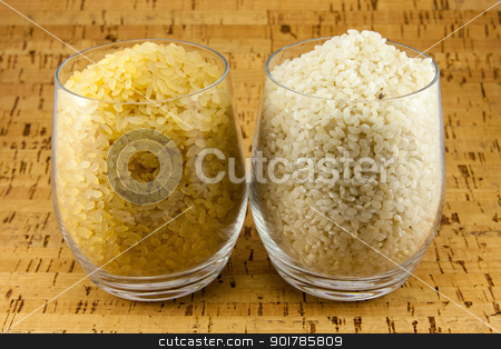 Two varieties of rice inside two transparent glasses stock photo, Two varieties of rice inside two transparent glasses by Sacha Ferrarelli