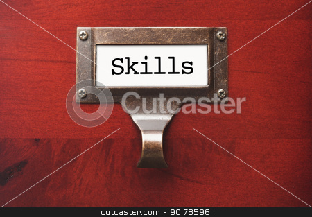 Lustrous Wooden Cabinet with Skills File Label stock photo, Lustrous Wooden Cabinet with Skills File Label in Dramatic LIght. by Andy Dean