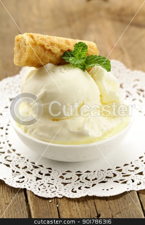 creamy vanilla ice cream in a white cup stock photo, creamy vanilla ice cream in a white cup by Olga Kriger
