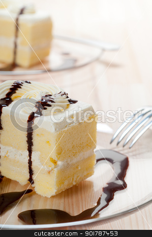 fresh cream cake closeup with chocolate sauce