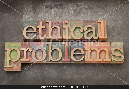 ethical problems in wood type stock photo, ethical problems - text in vintage letterpress wood type on a grunge metal background by Marek Uliasz