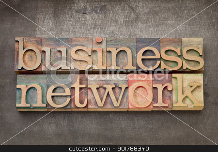 business network in wood type stock photo, business network - text in vintage letterpress wood type on a grunge metal background by Marek Uliasz