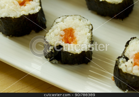 Sushi stock photo, Close up of sushi with salmon over a white plate by Fabio Alcini