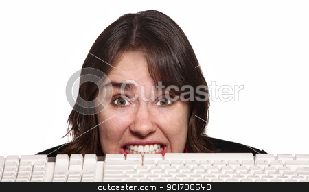 Nervous Woman Behind Keyboard stock photo, Woman with clenched teeth behind computer keyboard by Scott Griessel