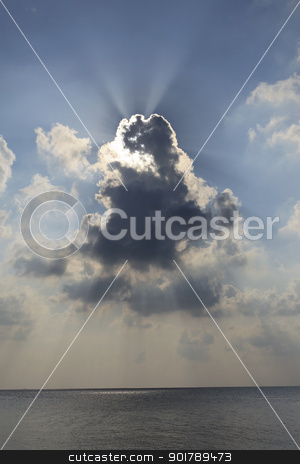 Sunlight stock photo, Sun rays piercing through clouds above the ocean by Abdul Sami Haqqani
