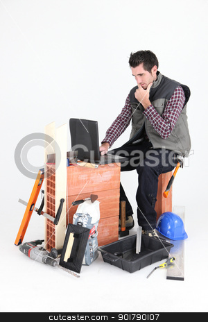 Bricklayer with a laptop stock photo, Bricklayer with a laptop by photography33
