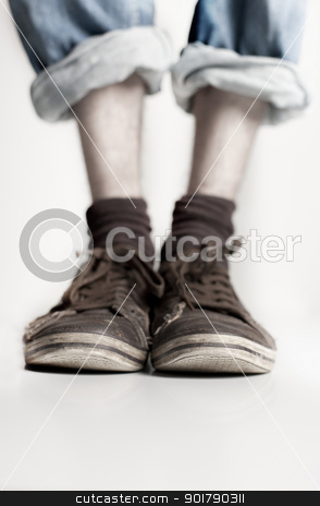 Legs with pair of shoes on them stock photo, Legs with pair of old shoes on them - shallow DOF by foto-fine-art