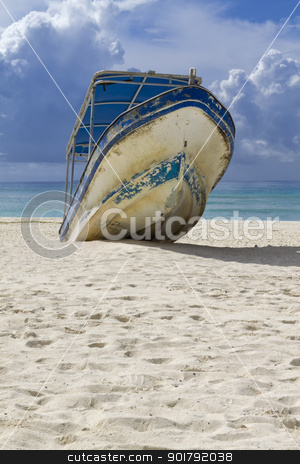 Beached Boat stock photo, A beached boat waiting for high tided by Kevin Tietz