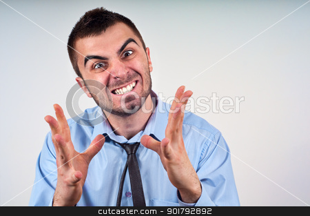 Man expressing frustration stock photo, Angry business man expressing frustration, portrait of young handsome businessman, concept of executive yelling, conversation problem communication crisis,anger,frustration.Room for text by borojoint