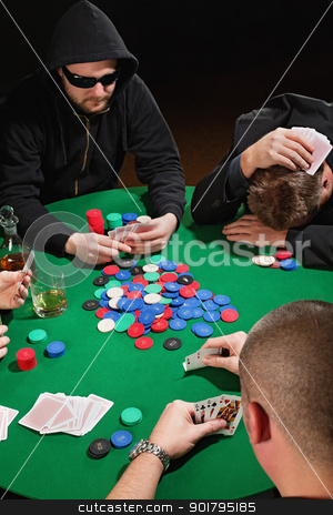 Poker stock photo, Photo of four men playing poker with one player frustrated. Focus is on the winning poker hand. by © Ron Sumners