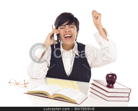 Excited Mixed Race Female Student on Cell Phone Cheers stock photo, Excited Mixed Race Female Student at Desk with Books on Cell Phone Cheers Isolated on a White Background. by Andy Dean