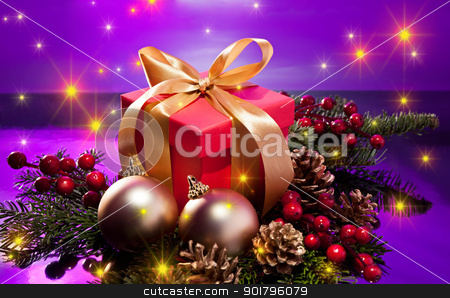 Red present box in a Christmas setting with glowing stars stock photo, Red present box in a Christmas setting with glowing stars over a purple background by Ulrich Schade