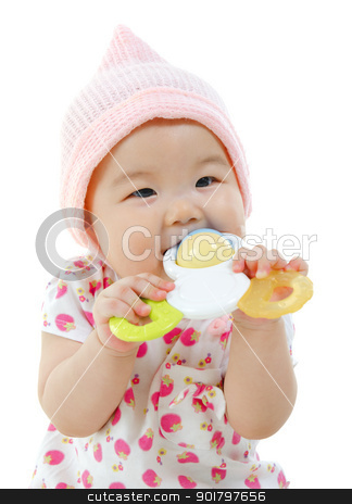 Tasting new toy. stock photo, Beautiful mixed race Asian baby girl biting with her toys. by szefei
