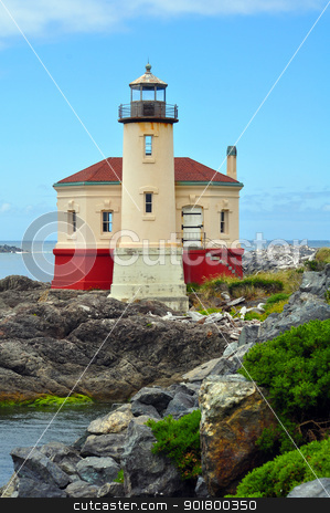 Lighthouse on the pacific coast stock photo, Lighthouse on the rocky pacific coast by perlphoto