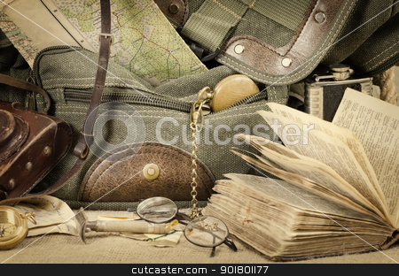 Travel theme still life stock photo, Still life with an old backpack and travel accessories by Sergej Razvodovskij