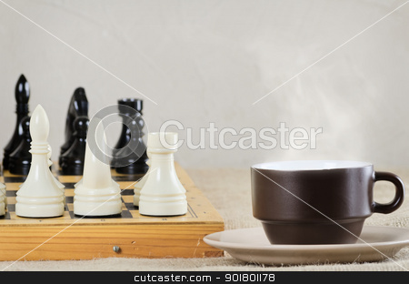 Chess stock photo, Teacup in front of chessboard  by Sergej Razvodovskij