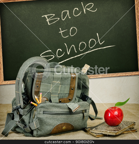 School theme still life stock photo, Still life with an old backpack, books and red apple  by Sergej Razvodovskij