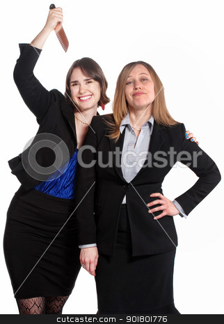 Backstabbing Employee stock photo, Smiling woman holds a knife behind clueless coworker by Scott Griessel