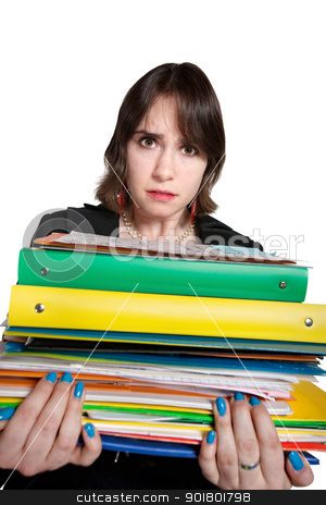 Worker with Stack of Binders stock photo, Overwhelmed young professional holds stack of binders by Scott Griessel