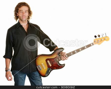 Calm Man With Electric Guitar stock photo, Sexy man holding electric guitar against his hip by Scott Griessel